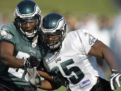 <b>Bye, bye Birdies:</b> Defensive end Jerome McDougle, right, blocks running back Ryan Moats, left, at Eagles training camp earlier this month. Moats, a former third-round draft pick, was cut Friday. McDougle, a former first-round pick, was cut today. (David Maialetti / Daily News)
