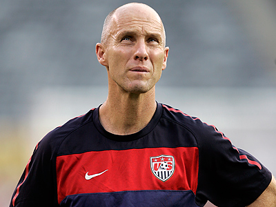 Bob Bradley will be the U.S. coach for another four more years. (AP Photo/Rich Schultz)