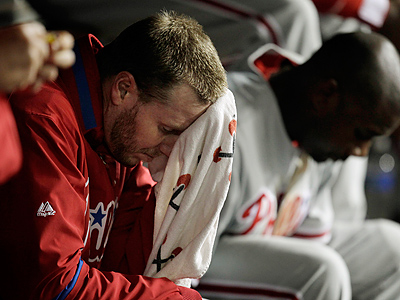 Roy Halladay wipes his face in the dugout during the sixth inning against the Los Angeles Dodgers. (AP Photo/Jae C. Hong)