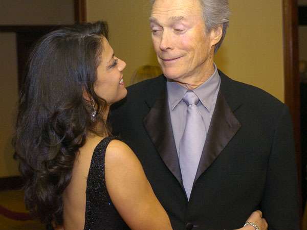 "Clint Eastwood, director of the film ""Mystic River,"" arrives with his wife Dina at the 56th Annual Directors Guild Awards at the Century Plaza Hotel in Los Angeles, Saturday, Feb. 7, 2004. Eastwood is one of the five nominees for Outstanding Directorial Achievement in Feature Film. (AP Photo/Chris Pizzello)"