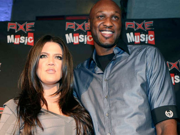 "Happier days: Khloe Kardashian, left, and Lamar Odom arrive at the AXE Music ""One Night Only"" concert series in Sept. 2010 in Los Angeles. (Shea Walsh / AP Images for AXE)"