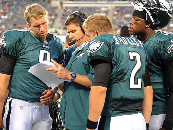 Eagles quarterbacks coach Bill Lazor talks with quarterbacks (from left) Nick Foles, Matt Barkley and Dennis Dixon. (Clem Murray/Staff Photographer)
