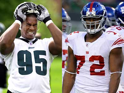 Eagles castoff Jerome McDougle, left, has reportedly joined the rival Giants to help replace injured Pro Bowler Osi Umenyiora.