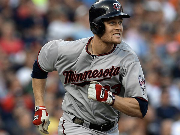 Minnesota Twins´ Justin Morneau runs after hitting a double against the Detroit Tigers in the third inning of a baseball game in Detroit, Wednesday, Aug. 21, 2013. (AP Photo/Paul Sancya)