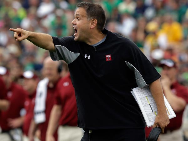 Temple head coach Mark Rhule yells to his team during the first half of an NCAA college football game against the Notre Dame in South Bend, Ind., Saturday, Aug. 31, 2013. (Michael Conroy/AP)