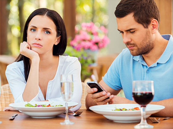 In a day and age when the use of technology is such an ingrained and instant form of daily communication, it can be confusing to figure out what types of conversation are appropriate or not, especially when you are in a committed relationship. (iStock)