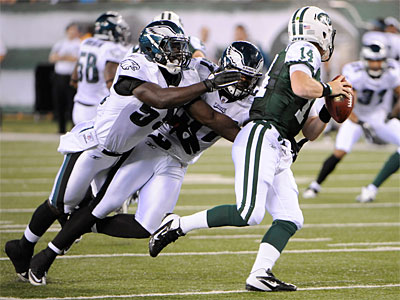 Eagles linebackers Brian Rolle, left, and Keenan Clayton sack Jets quarterback Greg McElroy (AP Photo/Bill Kostroun).