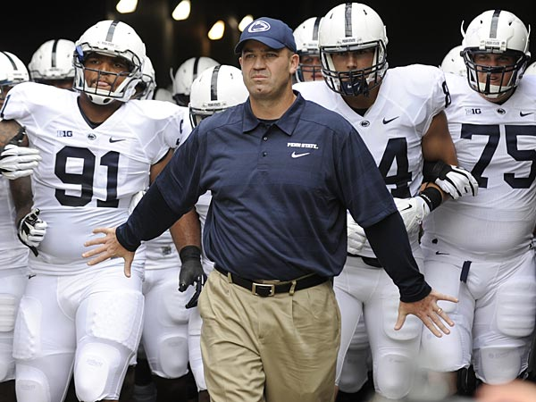 Penn State´s Bill O´Brien leads his team down the tunnel before an NCAA college football game against Syracuse,  Saturday, Aug. 31, 2013, in East Rutherford, N.J. Penn State won 23-17. (AP Photo/Centre Daily Times, Nabil K. Mark)