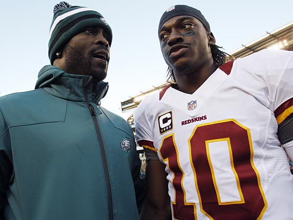Eagles quarterback Michael Vick (left) and Redskins quarterback Robert Griffin III (right). (Mel Evans/AP file photo)