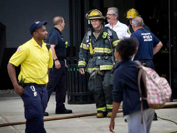 Crews from the Philadelphia Fire Department leave Millennium Hall at Drexel University after a reported chemical leak on the 11th floor on Wednesday, Sept. 3, 2014. (Alejandro A. Alvarez / staff)