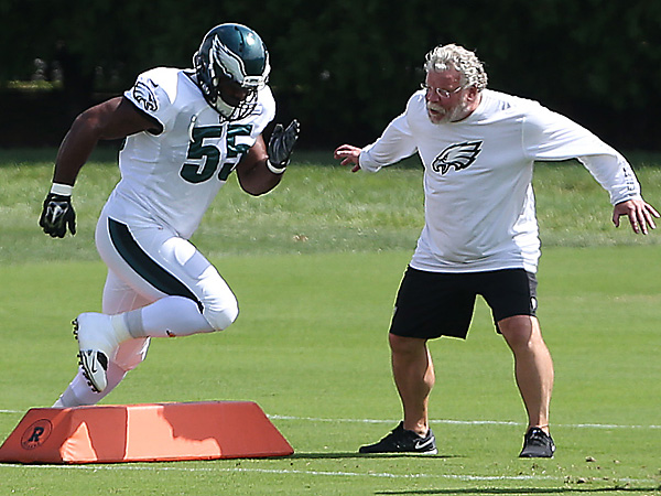 Brandon Graham works with Eagles defensive line coach Jerry Azzinaro. (David Maialetti/Staff Photographer)