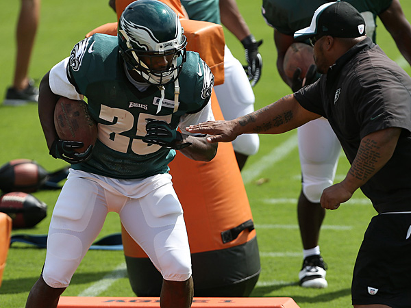 Eagles running back LeSean McCoy practices with assistant coach Duce Staley. (David Maialetti/Staff Photographer)