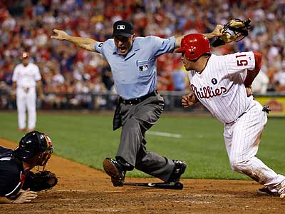 Carlos Ruiz is called safe at home plate in the fourth inning of Monday´s blowout win. (Yong Kim/Staff Photographer)