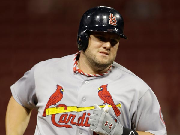 Cardinals´ Matt Adams rounds the bases after hitting a solo home run against the Cincinnati Reds in the 14th inning of a baseball game, Thursday, Sept. 5, 2013, in Cincinnati. (Al Behrman/AP)