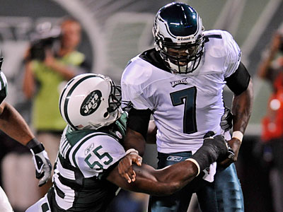 New York Jets defensive end Jamaal Westerman (55) sacks Philadelphia Eagles quarterback Michael Vick (7), forcing a fumble during the third quarter of an NFL preseason football game at Giants Stadium, Thursday, Sept. 3, 2009, in East Rutherford, N.J. (AP Photo/Bill Kostroun)