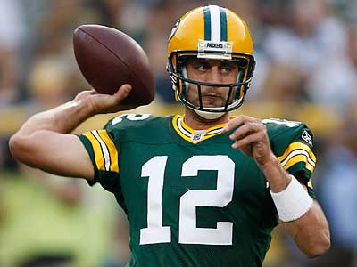 Aaron Rodgers and the Packers look to defend their Super Bowl title. (Mike Roemer/AP)