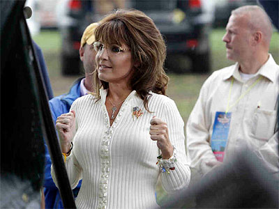 Sarah Palin waits backstage before speaking in Iowa. The former Alaska governor said it was not a campaign speech. (Charlie Neibergall / Associated Press)