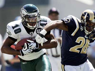 DeSean Jackson holds on as St. Louis Rams´ Tye Hill tries to grab the ball during the first quarter of the Eagles season opener. The Birds led 21-0 at halftime. (AP Photo/Mel Evans)
