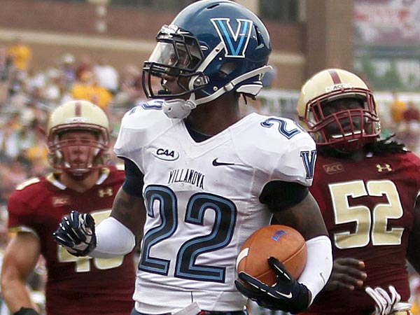 Villanova wide receiver Jamal Abdur-Rahman (22) rushes for a touchdown ahead of Boston College defenders during the first half of an NCAA college football game, Saturday, Aug. 31, 2013, in Boston. (AP Photo/Mary Schwalm)