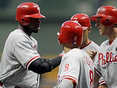 Ryan Howard hit a three-run home run in the first inning against the Brewers on Friday night. (Morry Gash/AP)