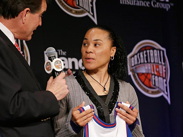 Three-time Olympic gold medalist Dawn Staley talks with CBS announcer Jim Nantz, left, during the Naismith Memorial Basketball Hall of Fame class announcement, Monday, April 8, 2013, in Atlanta, Georgia. (AP Photo/Charlie Neibergall)