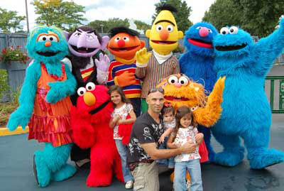 The Ibanezes at Sesame (top row): Rosita; Count von Count; Ernie; Bert; Grover; Cookie Monster. Bottom row: Elmo; daughter Sophia Isabella, 5; Raul Ibanez; daughter Carolina Danielle, 11 months; daughter Victoria Alessandra, 3; and Zoe.
