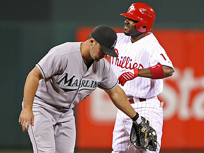 Jimmy Rollins grimaces after hitting a double in the third inning last night. (Michael Bryant / Staff Photographer)