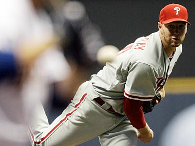 Roy Halladay and the Phillies pitching staff are on pace to set multiple team records. (Morry Gash/AP)