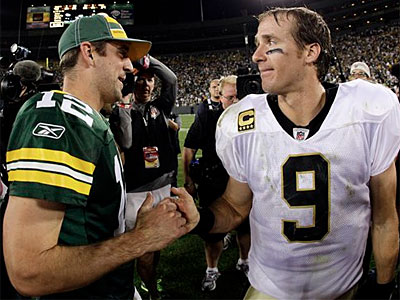 Aaron Rodgers and Drew Brees put on a show in the NFL opener Thursday night. (AP Photo/Morry Gash)