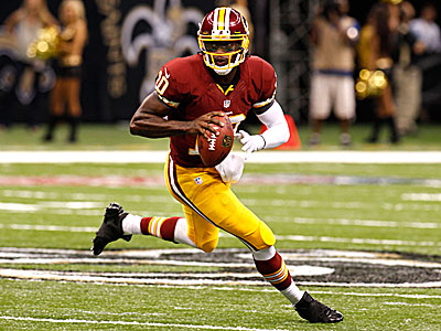 Redskins quarterback Robert Griffin III threw for 320 yards and two touchdowns against the Saints Sunday. (Bill Haber/AP)