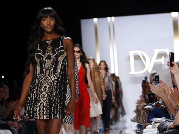 Model Naomi Campbell walks the runway in the Diane von Furstenburg Spring 2014 collection show during Fashion Week, Sunday, Sept. 8, 2013, in New York. (AP Photo/Jason DeCrow)