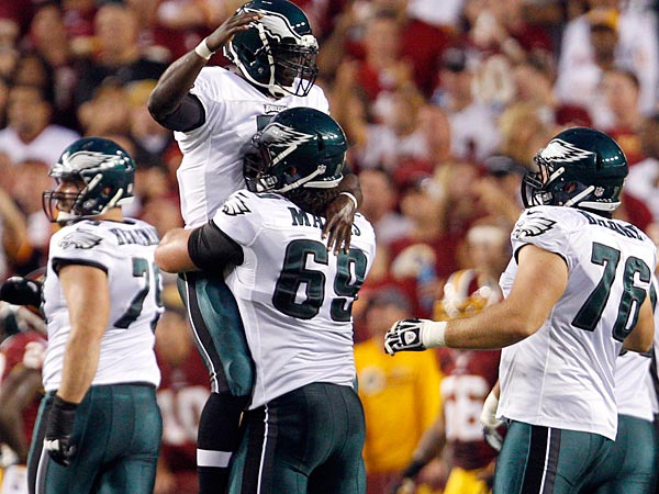 Eagles quarterback Michael Vick celebrates his first quarter touchdown pass with teammate Evan Mathis. (David Maialetti/Staff Photographer)