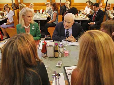 Republican presidential candidate Sen. John McCain and his wife Cindy eat lunch with a group of women at the Down Home Diner today. (Stephan Savoia/AP Photo)