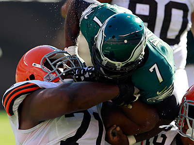 Michael Vick loses the football as he is hit by Ahtyba Rubin. (Yong Kim/Staff Photographer)