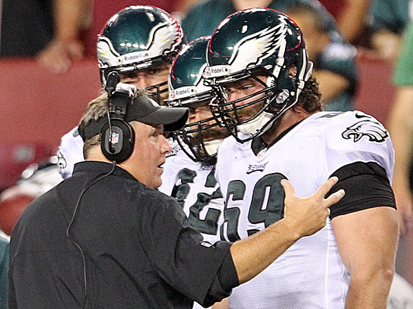 Eagles head coach Chip Kelly and offensive lineman Evan Mathis. (Yong Kim/Staff Photographer)