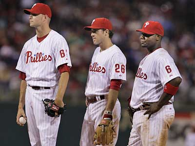 Ryan Madson, Chase Utley and Ryan Howard just don´t have the same look they had a year ago. It seems the Phillies have lost their fire. (Ron Cortes/Inquirer)