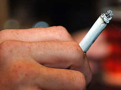Pennsylvania´s smoking ban went into effect today. Smokers will now have to leave restaurants and other public places to light up. (Sharon Gekoski-Kimmel / Inquirer).