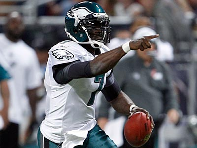 Michael Vick had 98 rushing yards in the Eagles´ 31-13 victory over the Rams. (Yong Kim/Staff Photographer)