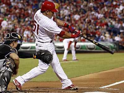 Carlos Ruiz drives in a run in the first inning against the Marlins on Tuesday. (Yong Kim/Staff Photographer)
