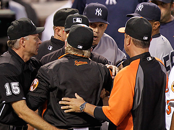Orioles manager Buck Showalter argues with Yankees manager Joe Girardi. (Luis M. Alvarez/AP)