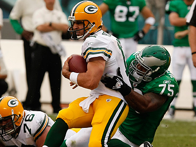 Juqua Parker sacks Packers quarterback Aaron Rodgers. (Ron Cortes / Staff Photographer)