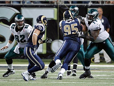 Eagles´ Jason Peters (right) and Jason Kelce watch Rams defenders.  (Yong Kim/Staff Photographer)