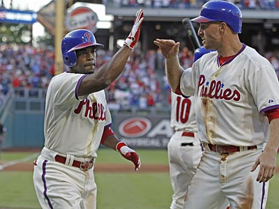 Jimmy Rollins celebrates his two-run home run against the Marlins with Pete Orr. (Michael Bryant/Staff Photographer)