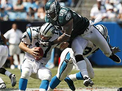Eagles defensive lineman Trent Cole takes down Panthers quarterback Jake Delhomme during the Birds´ 38-10 win in Week 1. (Ron Cortes / Staff Photographer)