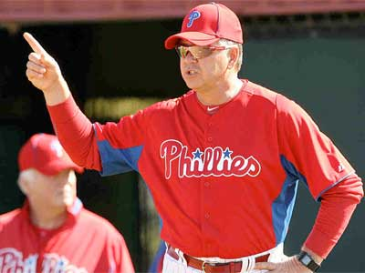 Rich Dubee and the rest of the Phillies coaching staff will return in 2012. (Yong Kim/Staff File Photo)