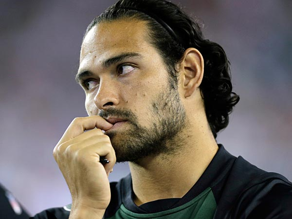 New York Jets quarterback Mark Sanchez watches from the sideline as his team plays the New England Patriots during the second quarter of an NFL football game Thursday, Sept. 12, 2013, in Foxborough, Mass. (AP Photo/Charles Krupa)