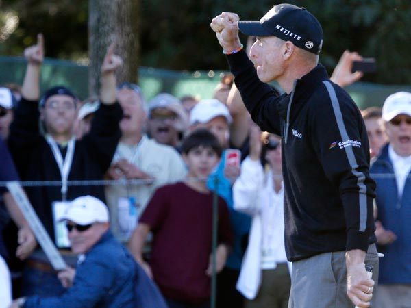 Jim Furyk pumps his fist after posting a 59, tying the PGA single round record, during the second round of the BMW Championship golf tournament at Conway Farms Golf Club in Lake Forest, Ill., Friday, Sept. 13, 2013. (Charles Rex Arbogast/AP)