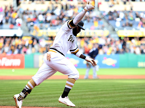 Pittsburgh Pirates left fielder Josh Harrison (5) reacts running to first base after hitting a game winning RBI single against the Milwaukee Brewers during the eleventh inning at PNC Park. The Pirates won 7-6 in eleven innings.