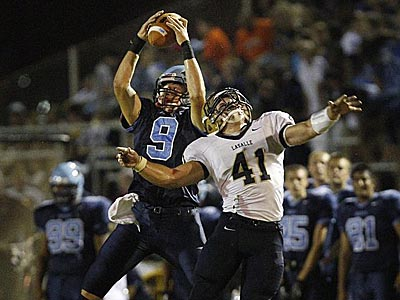 North Penn´s Colton Pyne makes a reception in front of LaSalle´s Mike Eife in the second quarter. (Ron Cortes/Staff Photographer).