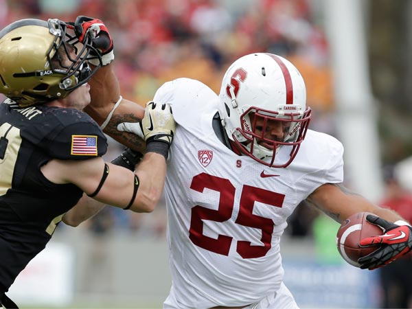 Stanford running back Tyler Gaffney (25) holds off Army linebacker Thomas Holloway (29) during the second half of an NCAA college football game on Saturday, Sept. 14, 2013, in West Point, N.Y. Gaffney was penalized for face masking. Stanford won, 34-20. (Mike Groll/AP)